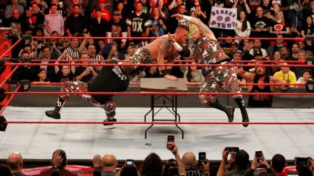 Dudley Boyz put The One-Man Band through the table