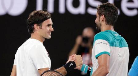 Roger Federer and Marin Cilic at the net following Australian Open final