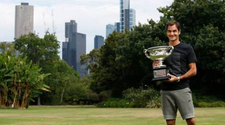 Roger Federer with the Australian Open trophy at governer's house