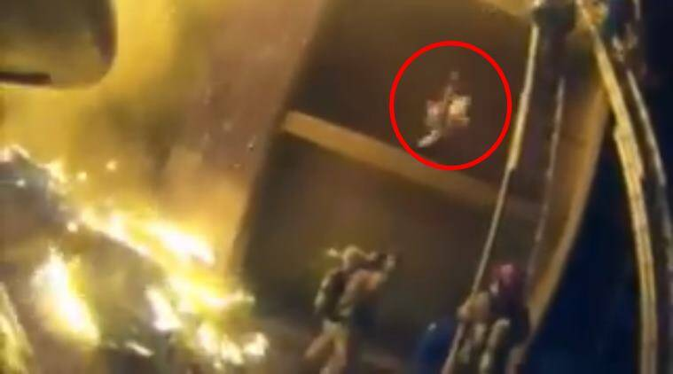 firefighter catches boy, firefighter video, video of firefighter saving child, us firefighter saving child, viral videos, rescue video, Indian express, Indian express news