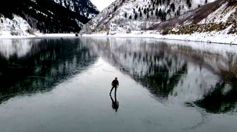 ice skater, drone footage, frozen lake, ice skating on frozen lake, ice skate drone, drone footage ice skater, indian express, indian express news