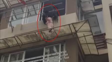 VIDEO: Man saves 2-yr-old girl hanging from thewindow