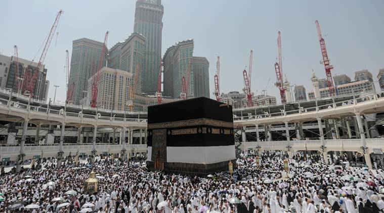 Muslim pilgrims circle the Kaaba the cubic building at the Grand Mosque in the Muslim holy city of Mecca