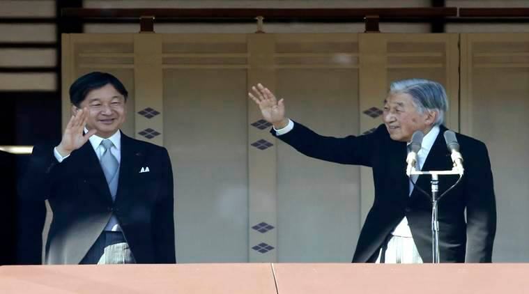 Japan emperor greets cheering crowd