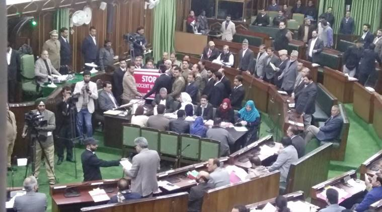 Opposition legislators surround the well in J&K Assembly