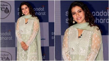 Kajol makes for a pretty picture in this beautiful pista green Anita Dongre suit