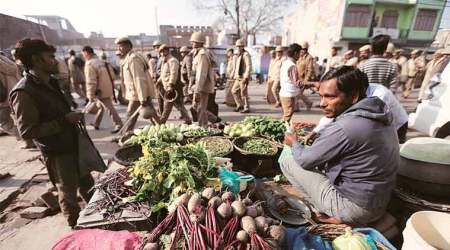 Kasganj tense, shops open under police vigil