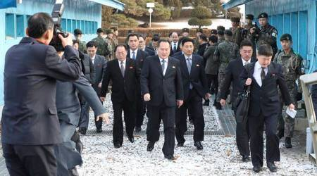 Head of North Korean delegation Ri Son Gwon, center, arrives at the South side for the meeting with South Korea at the Panmunjom in the Demilitarized Zone in Paju, South Korea.