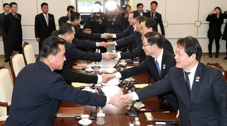 South and North Korean delegations attend the meeting at Panmunjom village in the demilitarised zone
