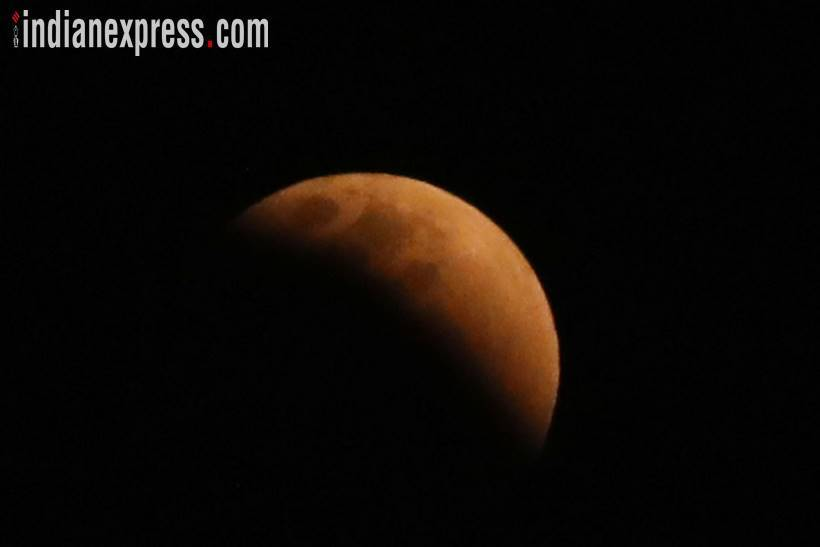 Lunar eclipse 2018: Super Blue Blood Moon was seen in the skies of several Indian cities including Delhi, Jaipur, Bhopal, Varanasi and Kolkata. (Source: Express photo by Partha Paul)