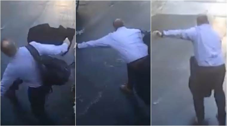 man sliding down ice, man falling on black ice, viral video of man falling on black ice, man rolls down driveway on ice, indian express, indian express news