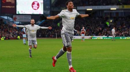 Anthony Martial helps Manchester United remain second