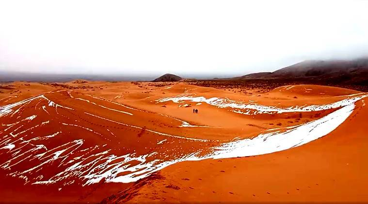 Snow falls on the usually quite hot Sahara Desert
