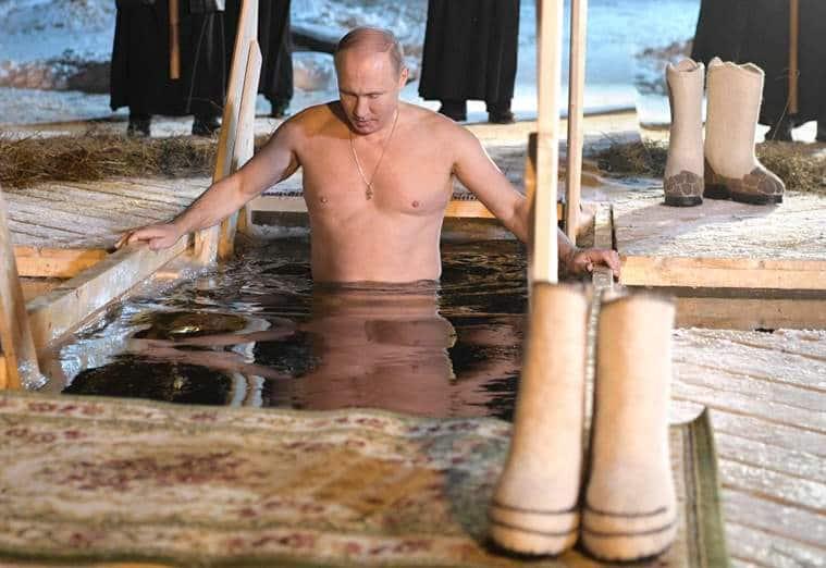 putin, icy dip, vladimir putin, putin ice water bath, russian president, putin photos, shirtless putin ice water, siberia, world news, putin ice challenge, indian express