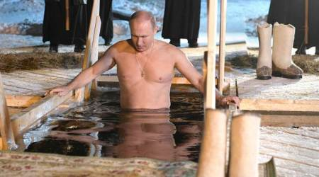 Russian President Vladimir Putin takes holy dip in icy waters