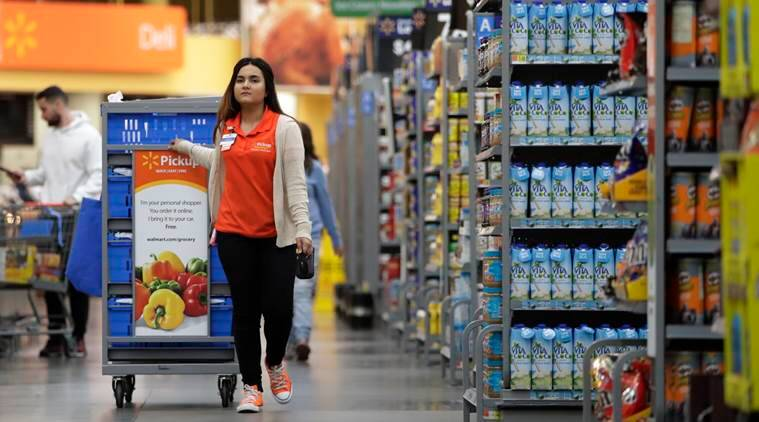 Walmart boosts starting pay, closing dozens of Sam's Clubs