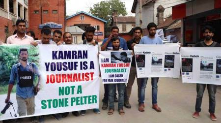 Kashmir editors' guild seeks photojournalist's release, slams NIA
