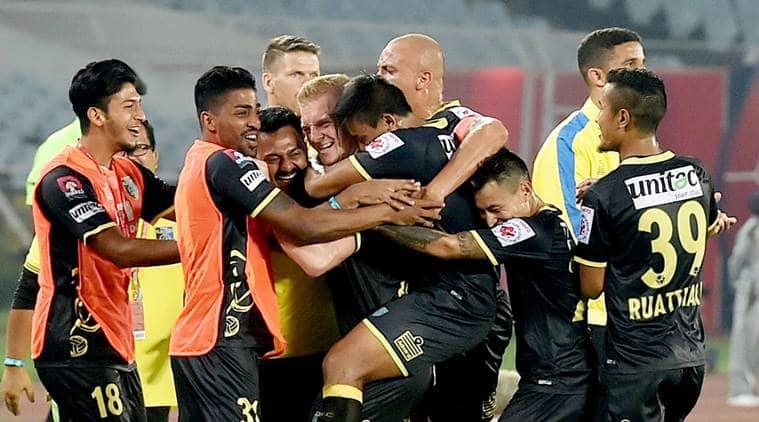 Kerala Blasters players celebrate a goal against ATK at Salt Lake Stadium