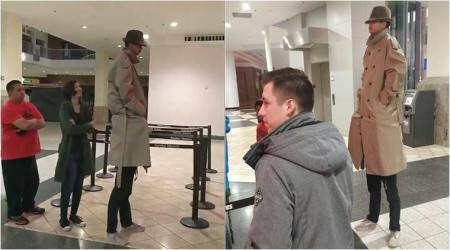 'Vincent Adultman, is that you?' Two kids try to watch Black Panther disguised as a VERY tall man!