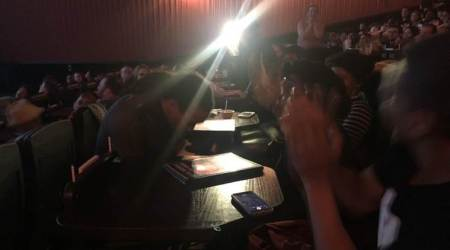 Man proposes in a Black Panther costume during the screening of the movie