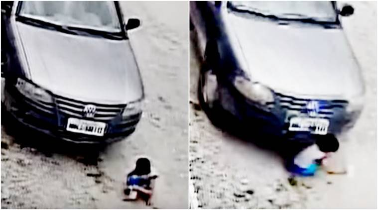 child run over by car, car runover video, child run over by car viral video, scary video, child run over car clip, viral videos, indian express, indian express news