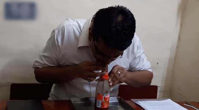 Guinness world record, guinness world record holder, man drinks ketchup, man creates record for drinking ketchup in record time, outrageous facts, indian express, indian express news