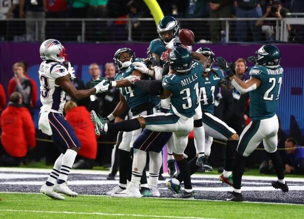Eagles players knock a hail mary pass from New England Patriots tight end Rob Gronkowski.