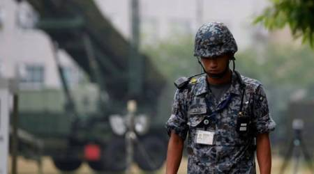 China, China two detained, two detained China, Japanese army uniforms, Japanese army, world news, latest world news, indian express, indian express news