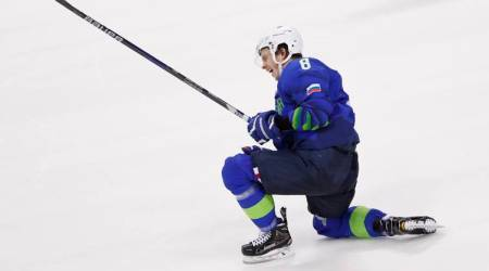 Ziga Jeglic of Slovenia celebrates after scoring the winning goal in a penalty shoot-out against Slovakia at Winter Olympics