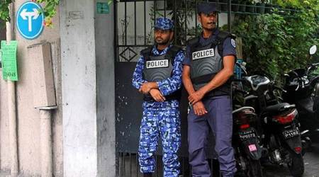 Maldivian police officers stand guard on a street after Maldives President Abdulla Yameen declared a state of emergency for 15 days in Male.
