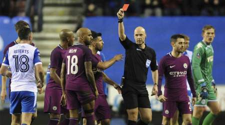 Ten-man Manchester City sunk by third-tier Wigan Athletic in FA Cupshock