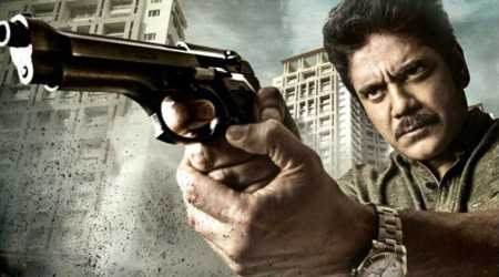Officer motion poster: Grief-stricken Ram Gopal Varma unveils Nagarjuna's cop look