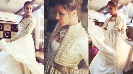 Neha Dhupia gives us another reason to crush on white in this Rohit Bal jacket
