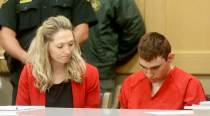 Head bowed, Florida shooting suspect returns to court forhearing
