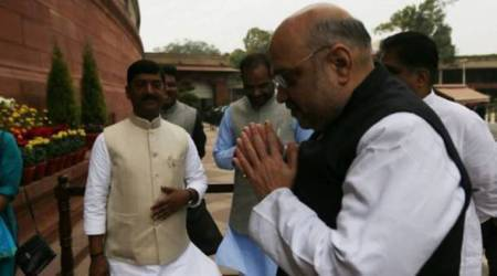 Amit Shah lashes out at Congress for criticising GST, Azad calls NDA 'name-changer' govt