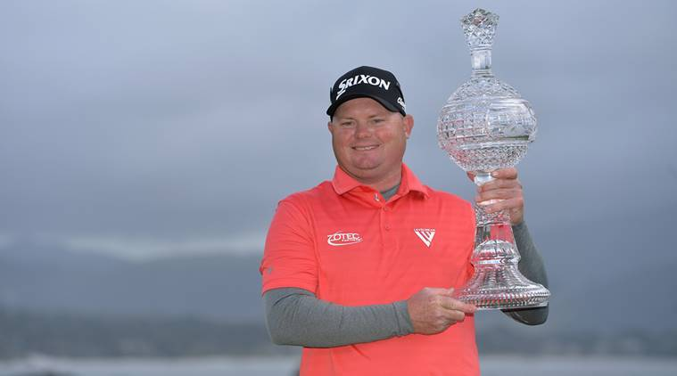 Ted Potter Jr poses with the trophy after winning Pebble Beach