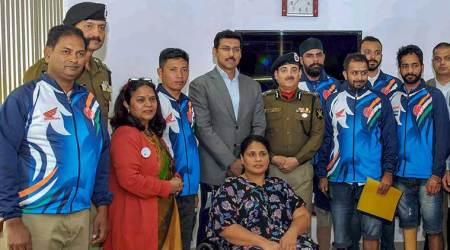 Sports Minister Rajyavardhan Singh Rathore congratulates Indian para-cycling contingent
