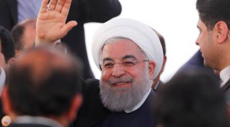 Iran President Hassan Rouhani pledges to stick to nuclear deal commitments