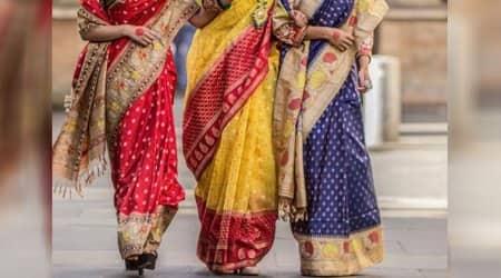 three women wearing sari