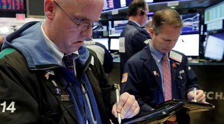 Traders Kevin Walsh, left, and Robert Charmak work on the floor of the New York Stock Exchange at the close of trading, Monday, Feb. 5, 2018. The Dow Jones industrial average plunged more than 1,100 points Monday as stocks took their worst loss in six and a half years. (AP Photo/Richard Drew)