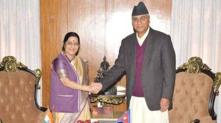 In a bid to mend ties, Sushma Swaraj assures Nepal support for politicalstability