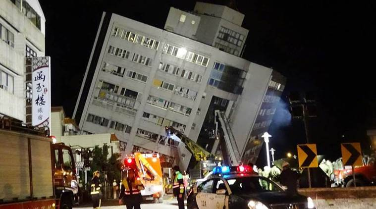Rescuers scour tilting buildings after Taiwan quake kills seven