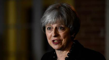 Under pressure at home, May demands new deal from EU on Irish border