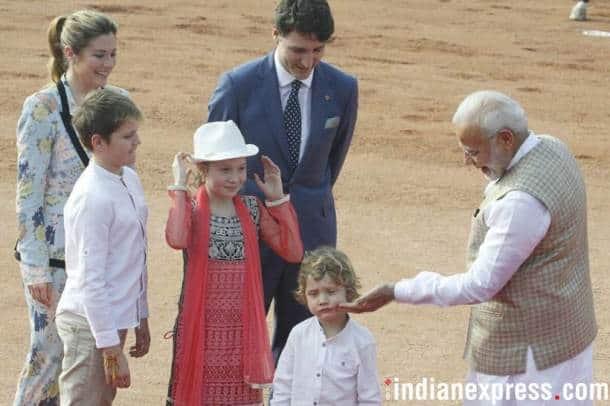 Justin Trudeau, Narendra Modi, Modi meets Trudeau, PM Modi hugs Trudeau, Trudeau India photos, Ceremonial Reception, Rashtrapati Bhavan, Indian Express