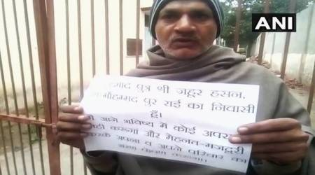 Fearing encounter, two alleged UP criminals carry placards with pledge not to commitcrime