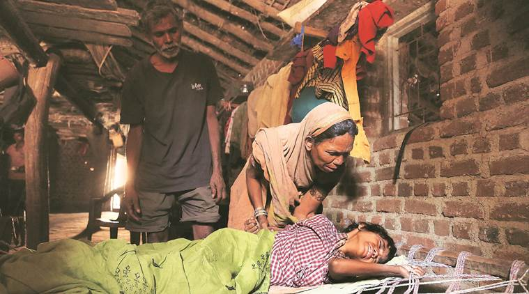 As the cot's ropes bite into her infected back, Ravita breaks down. (Express photo/Prashant Nadkar)