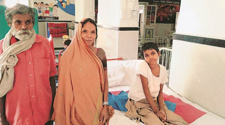 Ravita with her parents in a Mumbai hospital in February. (Express photo/Prashant Nadkar)