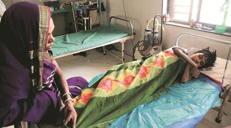Ravita with her mother at Dhadgaon Rural Hospital. (Express photo/Prashant Nadkar)
