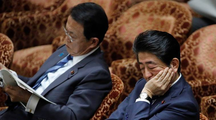 Abe apologizes for document alterations
