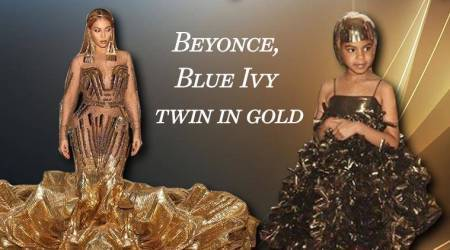 Beyonce channels a warrior princess look in her gold Falguni and Shane Peacock gown; Blue Ivy follows suit